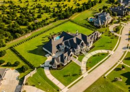 Countryside mansion aerial sun