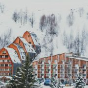 Snow covered wooden fronted hotel