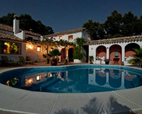villa with a pool at night with stars
