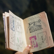 open passport with lots of stamps