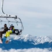 2 people on ski lift
