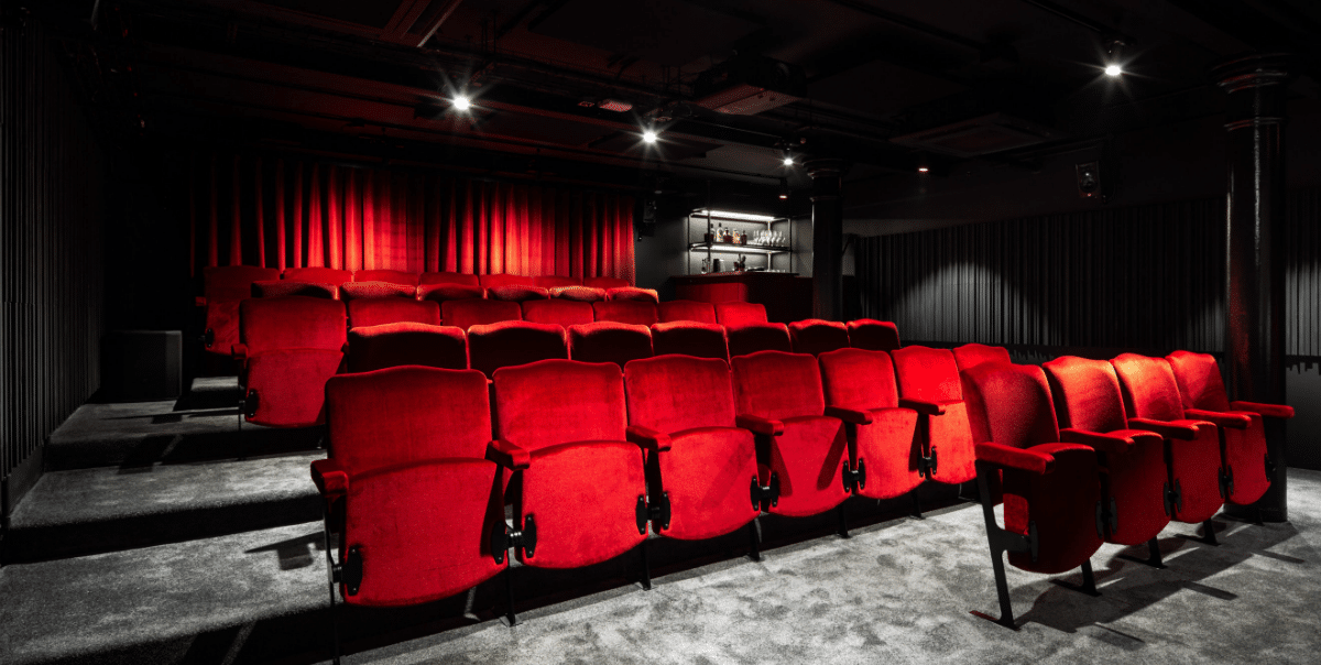 Small cinema with red velvet seats