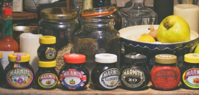 Row of Marmite jars, all different designs and colours