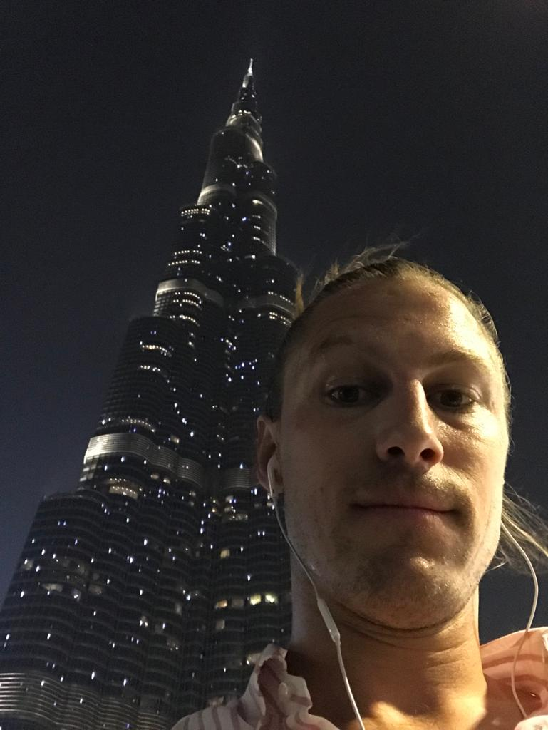 A selfie of our staff member Michael with the Burj Khalifa in the background