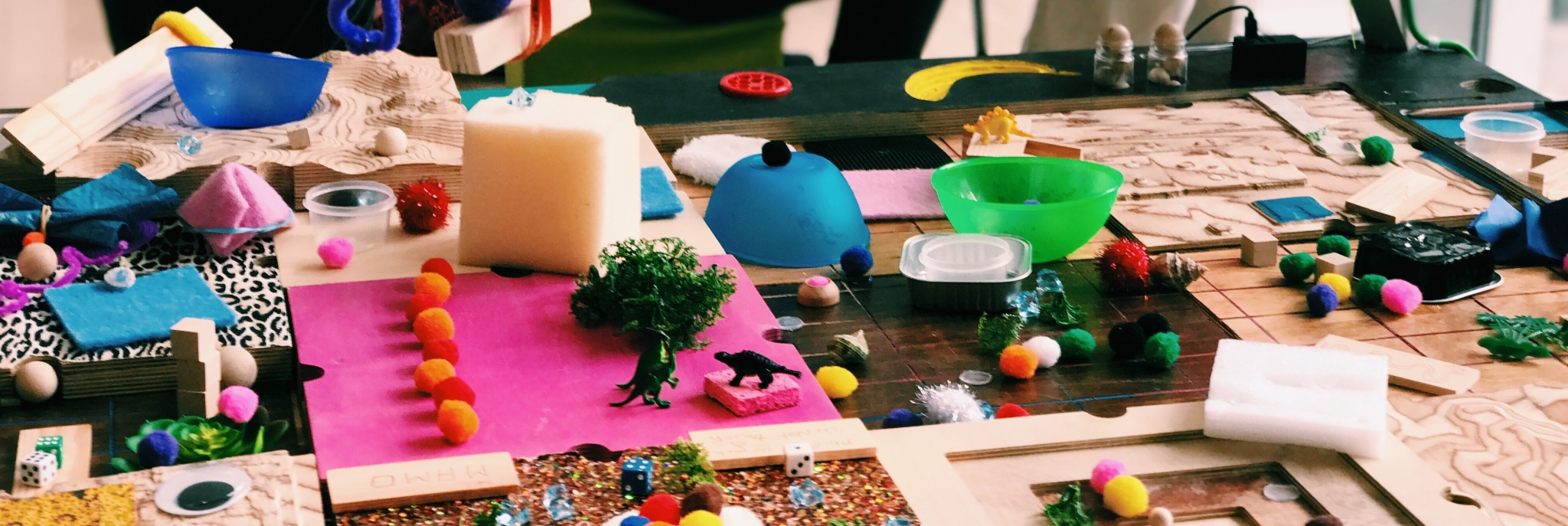 A table with various homemade kids crafts