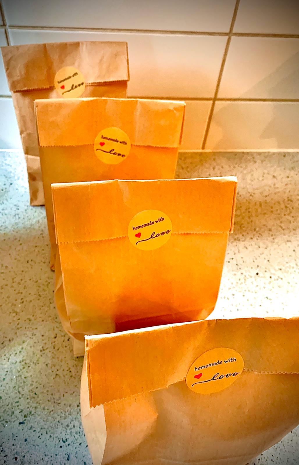 Brown paper bags of food, ready to be delivered by our chef