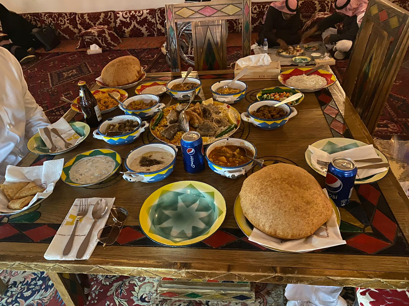 Middle Eastern food, laid out on a table in a restaurant