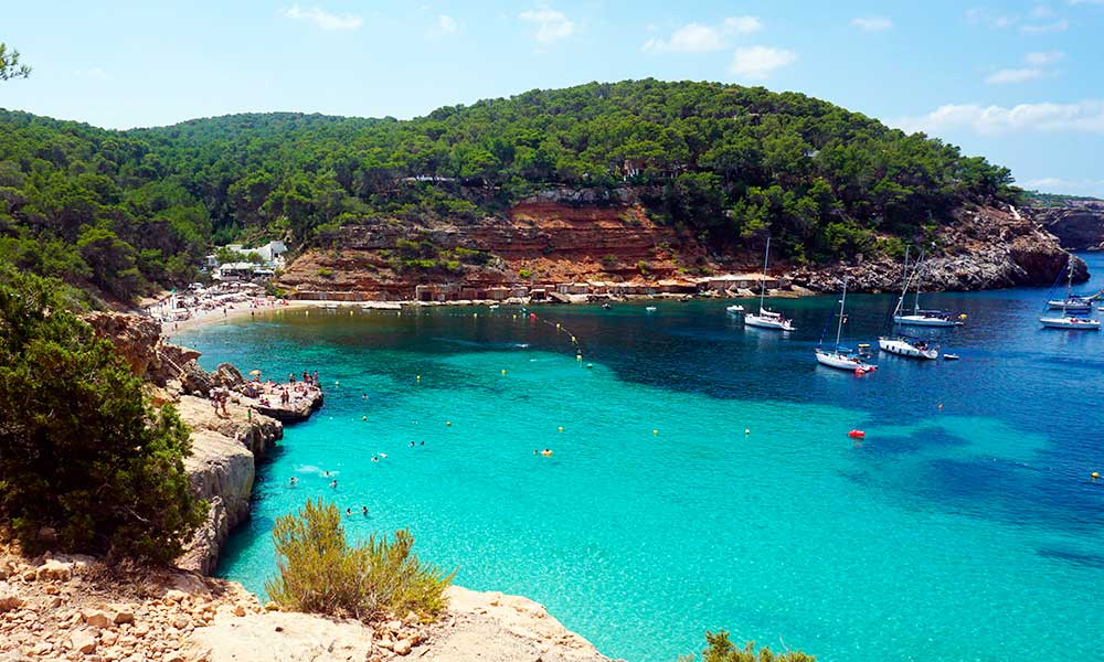 View of a beach cove from the top of rocks in Ibiza